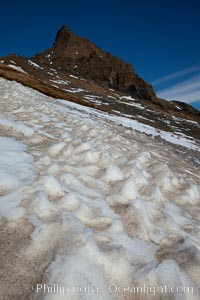 Crested snow patterns along the slopes of Devil Island