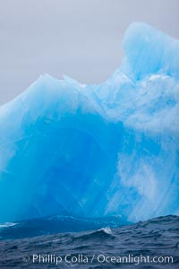 A blue iceberg.  Blue icebergs are blue because the ice from which they are formed has been compressed under such enormous pressure that all gas (bubbles) have been squeezed out, leaving only solid water that takes on a deep blue color, Scotia Sea