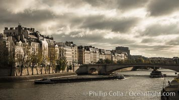 Ile Saint-Louis, is one of two natural islands in the Seine river, in Paris, France. The island is named after King Louis IX of France (Saint Louis). The island is connected to the rest of Paris by bridges to both banks of the river and by the Pont Saint Louis to the Ile de la Cite