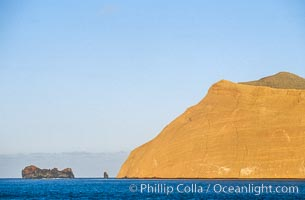 Isla Adentro (right) and Church Rock (partially obscured), sunrise. Guadalupe Island (Isla Guadalupe), Baja California, Mexico, natural history stock photograph, photo id 06138