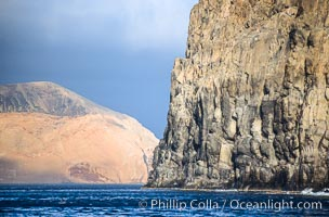El Moro, a huge volcanic headland at the south end of Guadalupe Island, is seen here partially obscuring the more distant Isla Adentro.  Daybreak, Guadalupe Island (Isla Guadalupe)