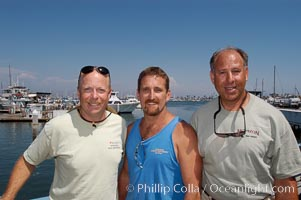 Joe Tobin (left), Doug Kuczkowski (center) and Craig OConnor (right).  In July 2004 OConnor shot a pending spearfishing world record North Pacific yellowtail (77.4 pounds), taken on a breathold dive with a band-power speargun near Battleship Point, Guadalupe Island (Isla Guadalupe), Mexico, July 2004.  Kuczkowski is the current record holder (77.0 pounds, July 1999) and Tobin is former record holder (74 pounds, July 1999). H&M Landing, San Diego, California, USA, natural history stock photograph, photo id 09747