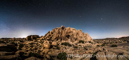 Jumbo Rocks and Stars at Night, landscape lit by a full moon, Joshua Tree National Park, California