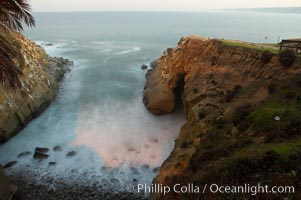 La Jolla Cave and rocky cove, waves blur at sunrise