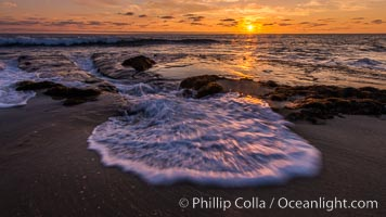 La Jolla coast sunset, waves wash over sandstone reef, clouds and sky