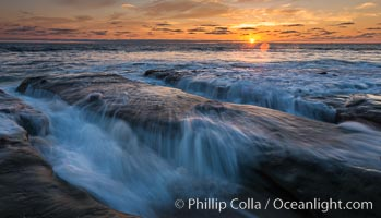 La Jolla coast sunset, waves wash over sandstone reef, clouds and sky. California, USA, natural history stock photograph, photo id 27893