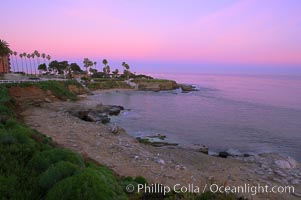 La Jolla Cove meets the dawn with pink skies and a flat ocean