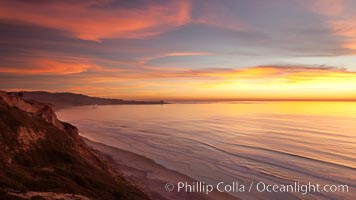 Sunset falls upon Torrey Pines State Reserve, viewed from the Torrey Pines glider port.  La Jolla, Scripps Institution of Oceanography and Scripps Pier are seen in the distance