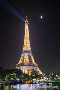 Image 28203, River Seine, Full Moon and Eiffel Tower at night, Paris. La Tour Eiffel. The Eiffel Tower is an iron lattice tower located on the Champ de Mars in Paris, named after the engineer Gustave Eiffel, who designed the tower in 1889 as the entrance arch to the 1889 World's Fair. The Eiffel tower is the tallest structure in Paris and the most-visited paid monument in the world. Tour Eiffel, Paris, France, Phillip Colla, all rights reserved worldwide. Keywords: champ de mars, eiffel tower, france, gustave eiffel, la tour eiffel, la tour eiffel, monument, paris, tower.