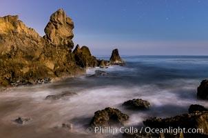Little Corona Beach, at night under a full moon, waves lit by moonlight, Newport Beach, California