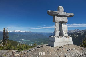 Ilanaaq, the logo of the 2010 Winter Olympics in Vancouver, is formed of stone in the Inukshuk-style of traditional Inuit sculpture.  Located near the Whistler mountain gondola station, overlooking Whistler Village and Green Lake in the distance. Whistler, British Columbia, Canada, natural history stock photograph, photo id 21007