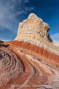 Brilliant red striations around the base of this pinnacle are responsible for its name: the Lollipop, White Pocket, Vermillion Cliffs National Monument, Arizona
