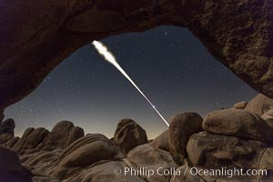 Lunar Eclipse Sequence, the path of the moon through the sky as it progresses from being fully visible (top) to fully eclipsed (middle) to almost fully visible again (bottom), viewed through Arch Rock, April 4 2015. Joshua Tree National Park, California, USA, natural history stock photograph, photo id 30713