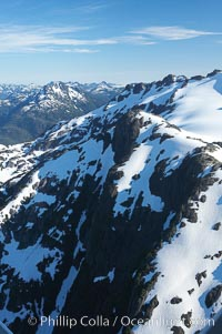 Mariner Mountain, viewed from the northeast, on the west coast of Vancouver Island, British Columbia, Canada, part of Strathcona Provincial Park, located 36 km (22 mi) north of Tofino.  It is 1,771 m (5,810 ft) high, snow covered year-round and home to several glaciers