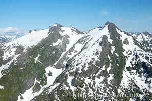 Mariner Mountain, viewed from the northwest, on the west coast of Vancouver Island, British Columbia, Canada, part of Strathcona Provincial Park, located 36 km (22 mi) north of Tofino.  It is 1,771 m (5,810 ft) high, snow covered year-round and home to several glaciers