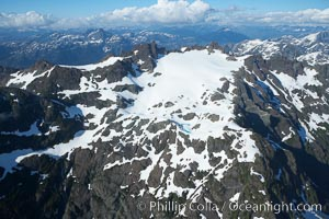 Mariner Mountain, on the west coast of Vancouver Island, British Columbia, Canada, part of Strathcona Provincial Park, located 36 km (22 mi) north of Tofino.  It is 1,771 m (5,810 ft) high, snow covered year-round and home to several glaciers