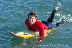 Ryan Seelbach paddles out to the lineup for his heat four surf, Seelbach would advance to the semis, Mavericks surf contest, February 7, 2006, Half Moon Bay, California