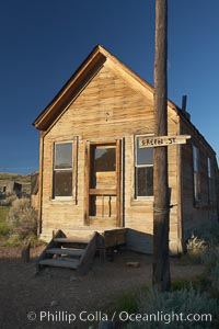 Image 23138, McMillan House, Green Street and Wood Street. Bodie State Historical Park, California, USA, Phillip Colla, all rights reserved worldwide. Keywords: arrested decay, bodie, bodie ghost town, bodie state historic park, bodie state historical park, bridgeport, california, eastern sierra, ghost town, gold mine, gold mining, gold rush, historic state park, home, house, mining camp, mining town, old west, outdoors, outside, shack, sierra, state park, state parks, town, usa, village, west, wooden house.