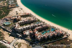 Aerial view of Medano Beach in Cabo San Lucas, showing many resorts along the long white sand beach
