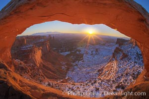 Mesa Arch spans 90 feet and stands at the edge of a mesa precipice thousands of feet above the Colorado River gorge. For a few moments at sunrise the underside of the arch glows dramatically red and orange. Island in the Sky, Canyonlands National Park, Utah, USA, natural history stock photograph, photo id 18085