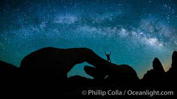 The Milky Way galaxy arches over Arch Rock on a clear evening in Joshua Tree National Park. California, USA, natural history stock photograph, photo id 26792