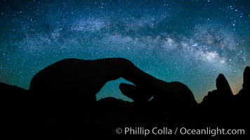 The Milky Way galaxy arches over Arch Rock on a clear evening in Joshua Tree National Park. California, USA, natural history stock photograph, photo id 26798