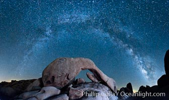 The Milky Way galaxy arcs above Arch Rock, panoramic photograph, cylindrical projection. Joshua Tree National Park, California, USA, natural history stock photograph, photo id 26848