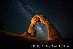 Milky Way arches over Delicate Arch, as stars cover the night sky. Arches National Park, Utah, USA, natural history stock photograph, photo id 27852
