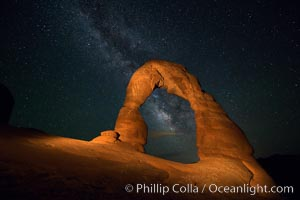 Milky Way arches over Delicate Arch, as stars cover the night sky. Arches National Park, Utah, USA, natural history stock photograph, photo id 27853