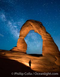 Milky Way arches over Delicate Arch, as stars cover the night sky. Arches National Park, Utah, USA, natural history stock photograph, photo id 27856
