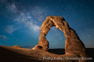 Image 27858, Milky Way arches over Delicate Arch, as stars cover the night sky. Arches National Park, Utah, USA, Phillip Colla, all rights reserved worldwide. Keywords: arches national park, astrophotography, evening, landscape astrophotography, national park, night, utah.