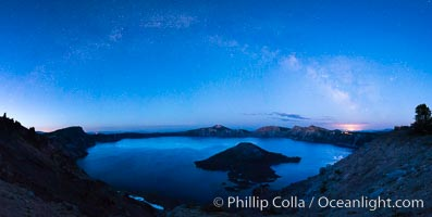 Milky Way and stars over Crater Lake at night. Panorama of Crater Lake and Wizard Island at night, Crater Lake National Park