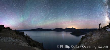 Air glow faint aurora borealis and stars over Crater Lake at night. Panorama of Crater Lake and Wizard Island at night, Crater Lake National Park