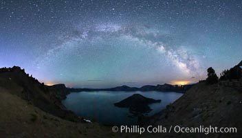 Image 28640, Milky Way and stars over Crater Lake at night. Panorama of Crater Lake and Wizard Island at night, Crater Lake National Park. Crater Lake National Park, Oregon, USA, Phillip Colla, all rights reserved worldwide. Keywords: astrophotography, crater, crater lake, crater lake national park, dusk, evening, galaxy, lake, landscape, landscape astrophotography, milky way galaxy, national park, national parks, nature, night, oregon, outdoors, outside, panorama, panoramic photo, scene, scenery, scenic, stars, sunset, usa.