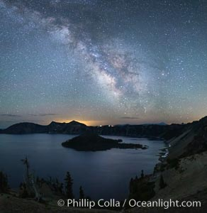 Image 28645, Milky Way and stars over Crater Lake at night. Panorama of Crater Lake and Wizard Island at night, Crater Lake National Park. Oregon, USA, Phillip Colla, all rights reserved worldwide. Keywords: astrophotography, crater, crater lake, crater lake national park, dusk, evening, galaxy, lake, landscape, landscape astrophotography, milky way galaxy, national park, national parks, nature, night, oregon, outdoors, outside, panorama, panoramic photo, scene, scenery, scenic, stars, sunset, usa.