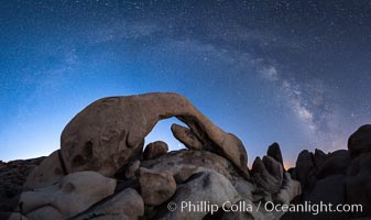 Milky Way over Arch Rock, planet Venus framed with the arch, at astronomical twilight, Joshua Tree National Park