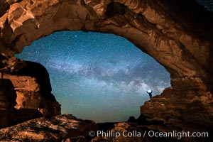 Hiker and Milky Way through North Window, Arches National Park. North Window, Arches National Park, Utah, USA, natural history stock photograph, photo id 29278