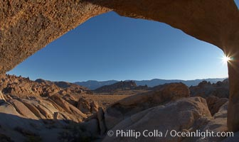 The Alabama Hills viewed through the natural stone arch of Mobius Arch, early morning, Alabama Hills Recreational Area