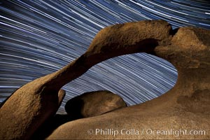 Mobius Arch in the Alabama Hills, seen here at night with swirling star trails formed in the sky above due to a long time exposure. Alabama Hills Recreational Area, California, USA, natural history stock photograph, photo id 27676