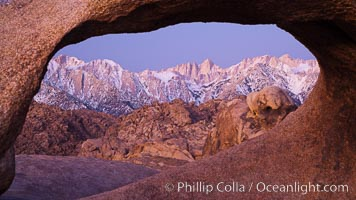 Mobius Arch at sunrise, framing snow dusted Lone Pine Peak and the Sierra Nevada Range in the background. Also known as Galen's Arch, Mobius Arch is found in the Alabama Hills Recreational Area near Lone Pine