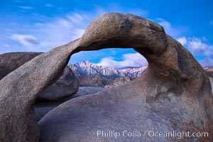 Mobius Arch at sunrise, framing snow dusted Lone Pine Peak and the Sierra Nevada Range in the background. Also known as Galen's Arch, Mobius Arch is found in the Alabama Hills Recreational Area near Lone Pine. California, USA, natural history stock photograph, photo id 27644