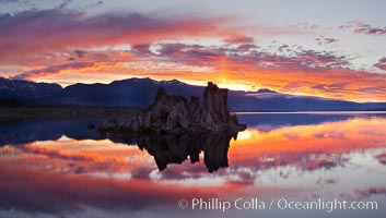 Mono Lake sunset, Sierra Nevada mountain range and tufas, clouds reflected in the still waters of Mono Lake