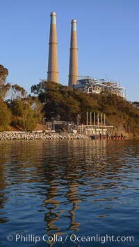 Moss Landing Power Plant rise above Moss Landing harbor and Elkhorn Slough.  The Moss Landing Power Plant is an electricity generation plant at Moss Landing, California.  The twin stacks, each 500 feet high, mark two generation units product 750 megawatts each