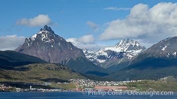 Mount Olivia (1318m) and the Five Brothers (Mount Cinco Hermanos, 1280m) in the Fuegian Andes rise above Ushuaia, the capital of the Tierra del Fuego region of Argentina.  The Beagle Channel fronts Ushuaia in the foreground