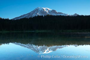 Mount Rainier is reflected in the calm waters of Reflection Lake, early morning. Mount Rainier National Park, Washington, USA, natural history stock photograph, photo id 13859
