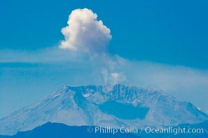 Mount St. Helens releases a burst of steam, viewed from Mount Rainier, Mount Rainier National Park, Washington