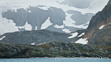 Mountainsides, rocky and snow covered, overlooking Drygalski Fjord. Drygalski Fjord, South Georgia Island, natural history stock photograph, photo id 24714
