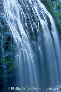 Narada Falls cascades down a cliff, with the flow blurred by a time exposure.  Narada Falls is a 188 foot (57m) waterfall in Mount Rainier National Park. Washington, USA, natural history stock photograph, photo id 13843