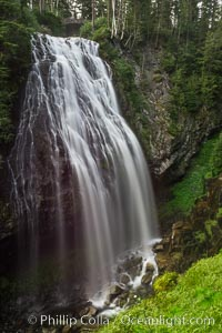 Narada Falls cascades down a cliff, with the flow blurred by a time exposure. Narada Falls is a 188 foot (57m) waterfall in Mount Rainier National Park