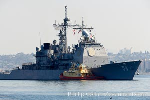 Navy ship with tug boat alongside, San Diego, California